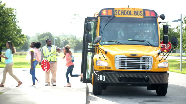 teacher and students exiting school bus - 12 13 years stock videos & royalty-free footage