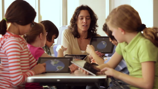 ms teacher and students learning about earth on tablet computers in school / richmond, virginia, usa - elementary age stock videos & royalty-free footage