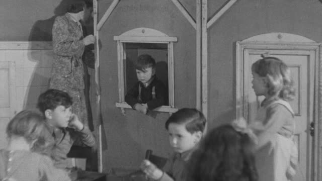 1947 montage teacher and young students in classroom / united kingdom - playhouse stock videos and b-roll footage