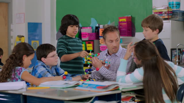 a teacher answers a question from a student as the class discusses molecular models. - molecular structure stock videos & royalty-free footage