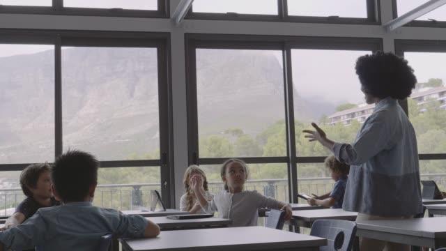 teacher asking elementary children in classroom - teacher stock videos & royalty-free footage