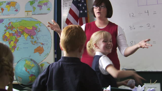 teacher calming down her class - see other clips from this shoot 1148 stock videos and b-roll footage