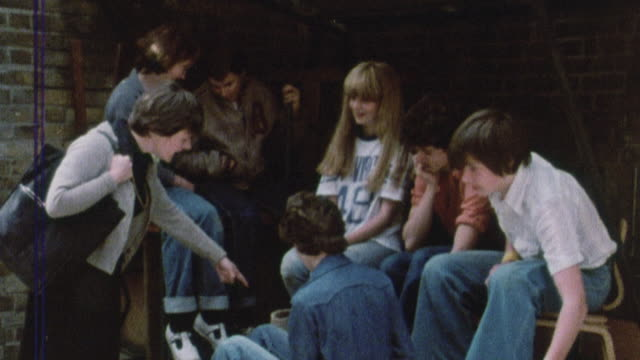 1978 montage teacher catching students smoking, students handing over cigarettes / united kingdom† - 1978 stock videos and b-roll footage