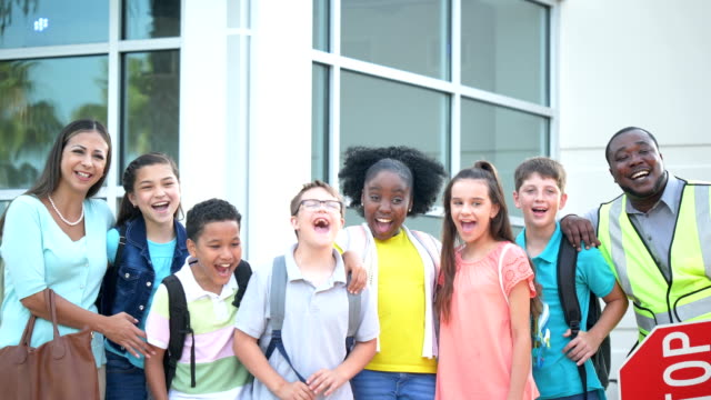 teacher, crossing guard, students, down syndrome boy - 12 13 years stock videos & royalty-free footage