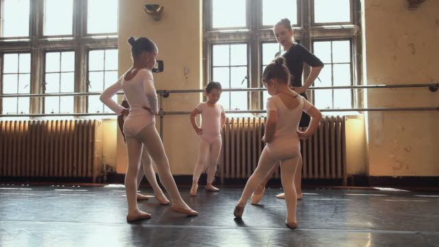 ws teacher demonstrates foot pointing techniques to students (2-7) during ballet class / chicago, illinois, usa - ballet dancing stock videos & royalty-free footage