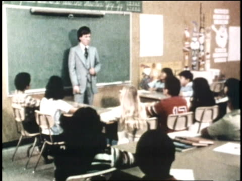 a teacher discusses astronomy with his junior high school students at an inner city school - 1970 stock videos & royalty-free footage