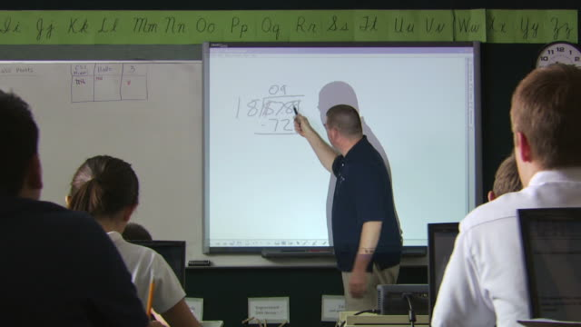 teacher doing a problem on the board - see other clips from this shoot 1148 stock videos and b-roll footage