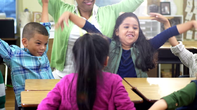 teacher, elementary students in classroom, flapping arms - 6 7 years stock videos & royalty-free footage