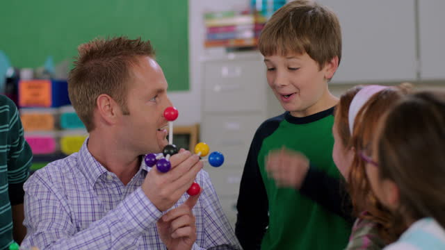 a teacher engages his students in identifying components of a molecular model. - emotion stock videos & royalty-free footage