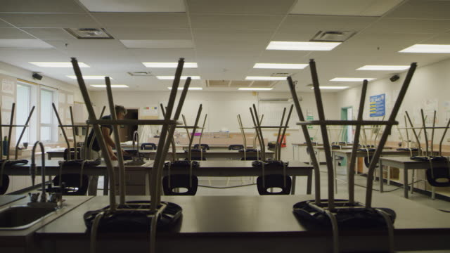teacher enters empty school classroom - canada politics stock videos & royalty-free footage