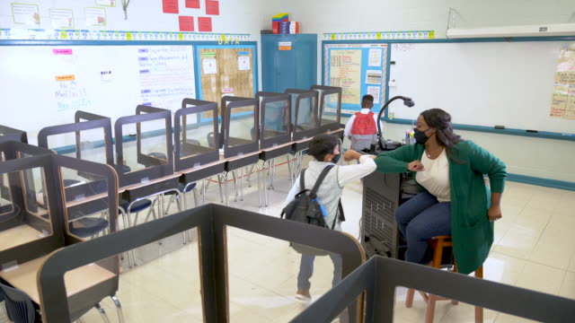 teacher greets students back to school during covid-19 - safety stock videos & royalty-free footage