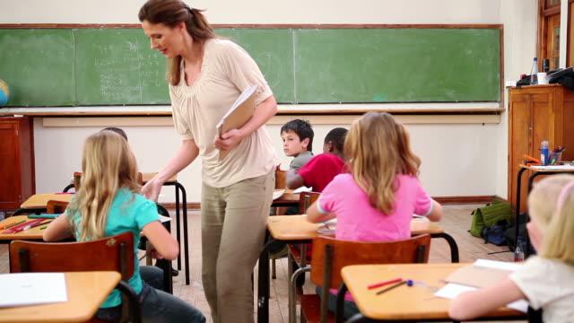 Teacher handing out homeworks