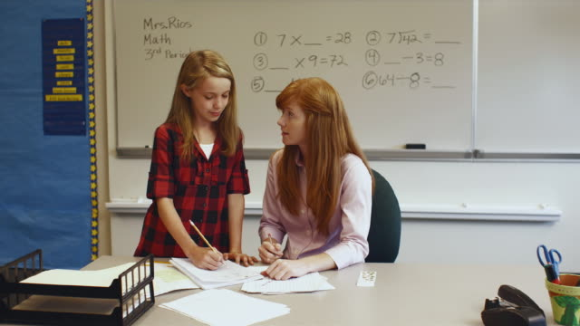 ws zo teacher helping student in classroom / edmonds, washington, usa - see other clips from this shoot 1750 stock videos and b-roll footage