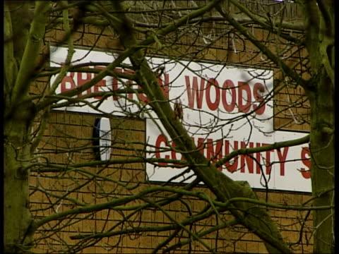 teacher in court for assaulting muslim girl itn peterborough school sign seen thru tree branches roof - 女性教師点の映像素材/bロール
