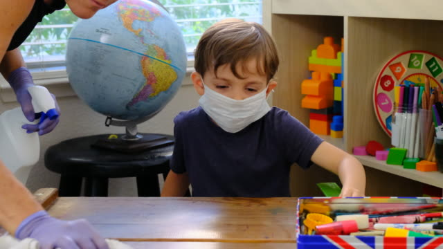 teacher is disinfecting 4 years old boy desk at the pre school - child care stock videos & royalty-free footage