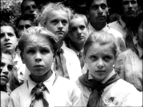 teacher leading schoolchildren past plaque honoring stalin's birthplace / row of schoolchildren looking up at birthplace / statue of joseph stalin /... - 1938 stock videos and b-roll footage