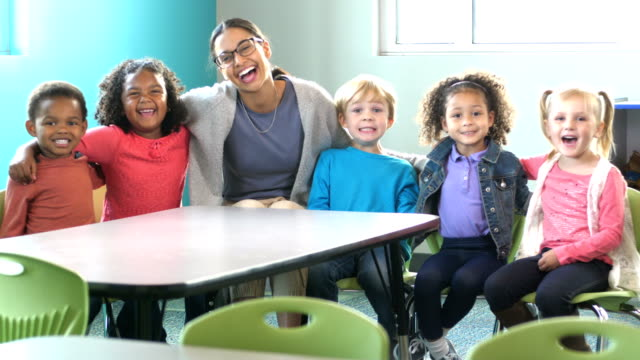 teacher, multi-ethnic group of preschoolers in classroom - teacher stock videos & royalty-free footage