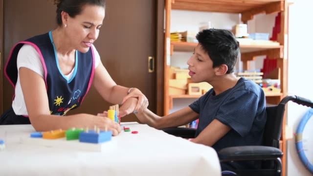 teacher playing with boy with cerebral palsy - cerebral palsy stock videos & royalty-free footage