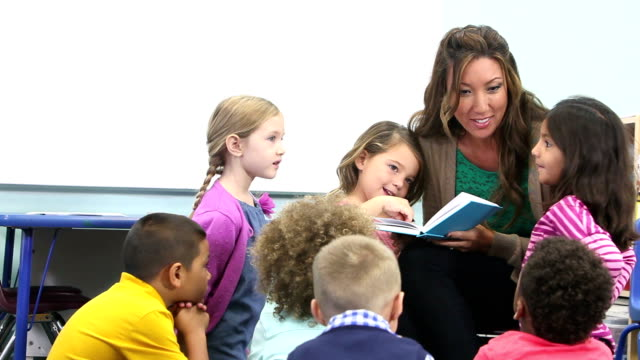 teacher reading and talking to class of school children - preschool child stock videos & royalty-free footage
