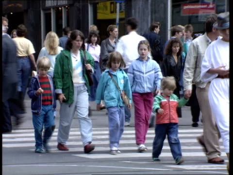 teacher shortage; itn netherlands: amsterdam: int/ext gv's amsterdam city centre, people sat on benches pullout to grand hotel krasnaposky / people... - aids video stock e b–roll
