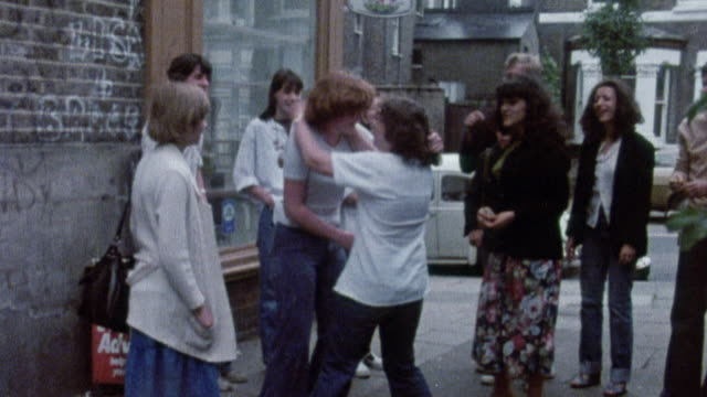 1978 MONTAGE Teacher stopping two students from fighting / United Kingdom†