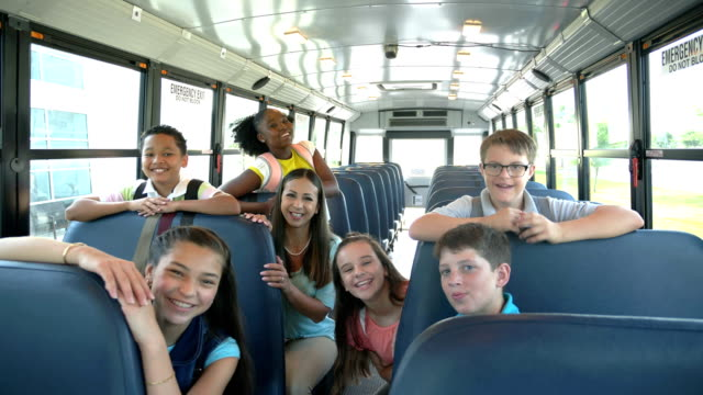 teacher, students, boy with down syndrome on school bus - 12 13 years stock videos & royalty-free footage