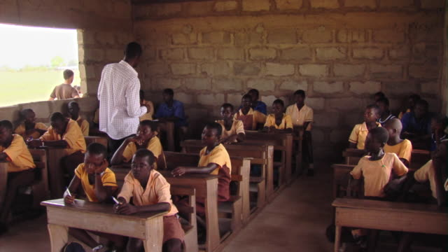 ms pan teacher talking to children in classroom, tamale, ghana - ghana stock videos and b-roll footage