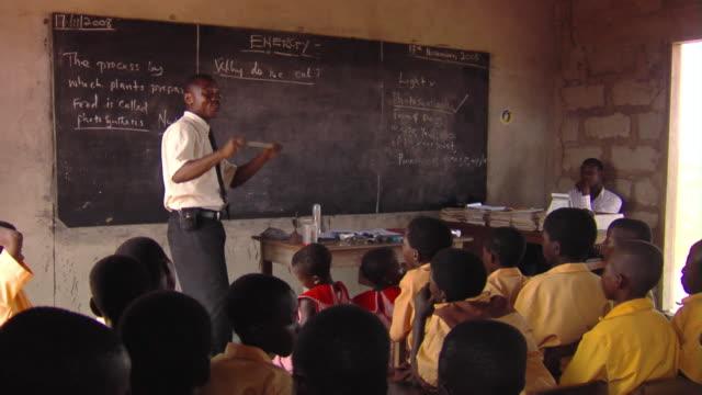ms teacher talking to children in classroom, tamale, ghana - ghana stock videos & royalty-free footage
