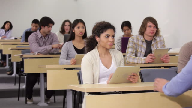 WS Teacher Talking to Diverse Group of Students Using Tablet Computers in Lecture Hall / Richmond, Virginia, USA
