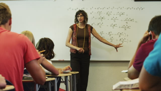 ms ds teacher talking to students during classes / spanish fork city, utah, usa - mathematical symbol stock videos & royalty-free footage