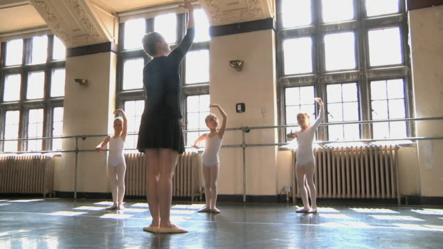 ws slo mo teacher teaching arm positions to her students (4-7) in ballet studio / chicago, illinois, usa - ballet studio stock videos and b-roll footage