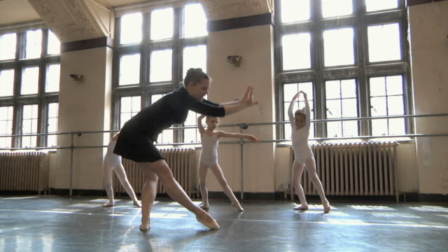 ws td zi slo mo teacher teaching feet positions to her students (4-7) in ballet studio / chicago, illinois, usa - ballet studio stock videos and b-roll footage