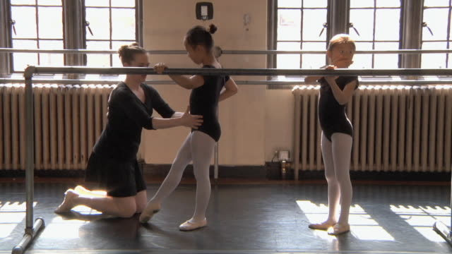 ws zo slo mo teacher teaching her students (6-7) with the aid of barre / chicago, illinois, usa - barre stock videos and b-roll footage
