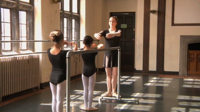 ms zi slo mo teacher teaching her students (6-7) with the aid of barre / chicago, illinois, usa - barre stock videos and b-roll footage