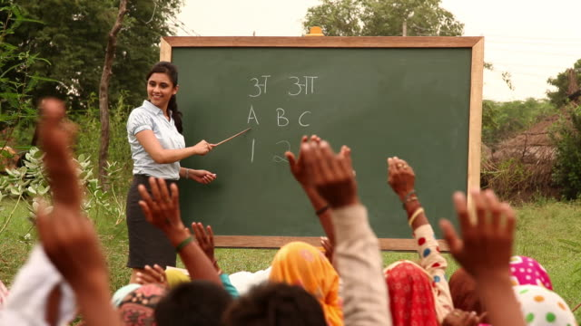 teacher teaching to rural people, haryana, india - 前ボケ点の映像素材/bロール