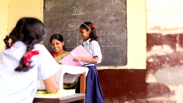 teacher teaching to school students in classroom, haryana, india - indian ethnicity stock videos and b-roll footage