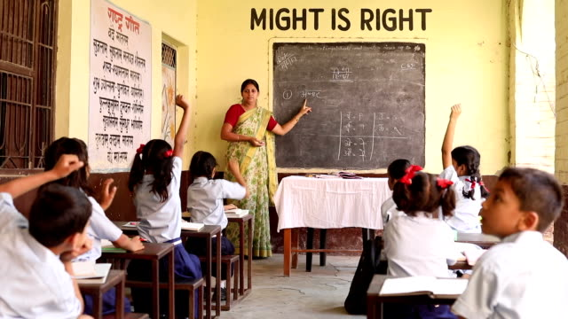 teacher teaching to school students in classroom, haryana, india - guidance stock videos & royalty-free footage