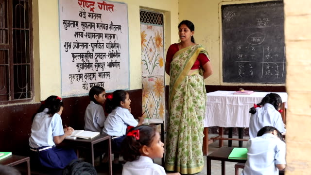 teacher teaching to school students in classroom, haryana, india - developing countries stock videos & royalty-free footage
