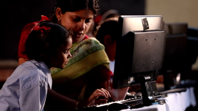 teacher teaching to schoolgirl in classroom, haryana, india - developing countries stock videos & royalty-free footage