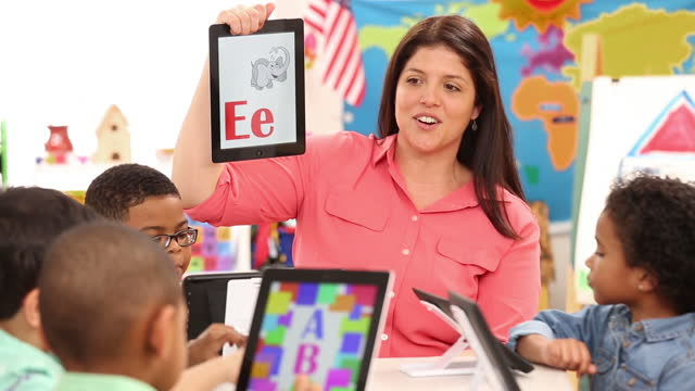 teacher using digital tablet to teach alphabet to kindergarteners - primary age child stock videos and b-roll footage