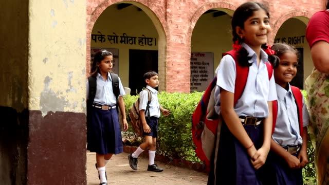 Teacher walking with school students, Haryana, India