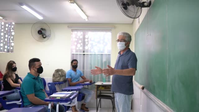 teacher wearing face mask teaching univestity / high school students - showing stock videos & royalty-free footage