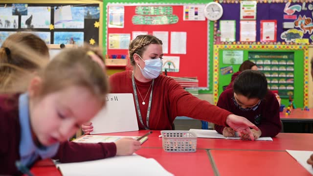 teacher wears a face mask during a maths lesson at glan-yr-afon primary school on march 3, 2021 in cardiff, wales. children aged three to seven began... - teacher stock videos & royalty-free footage