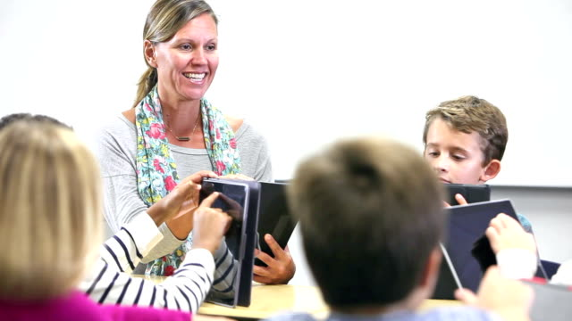 teacher with elementary school students, digital tablets - elementary school stock videos & royalty-free footage
