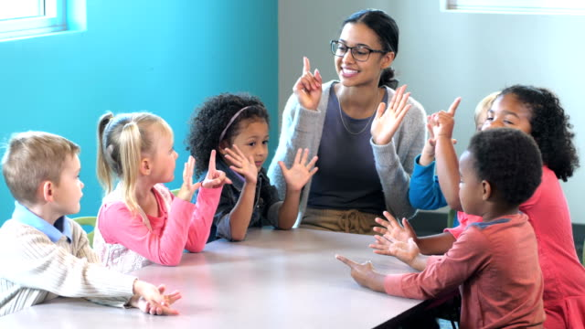 teacher with preschool students, counting on fingers - child care stock videos & royalty-free footage