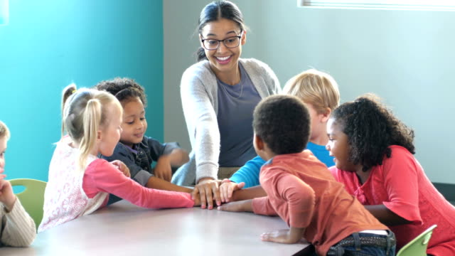 teacher with preschool students, playing a game - child care stock videos & royalty-free footage
