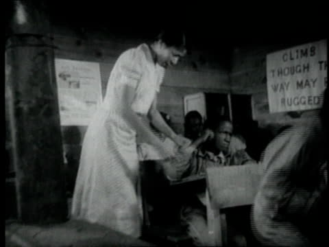 1940 montage teacher working with her class / united states - anno 1940 video stock e b–roll