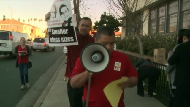 teachers from the los angeles unified school district were picketing outside many schools on february 12 as they demanded better classrooms and... - picchetto video stock e b–roll