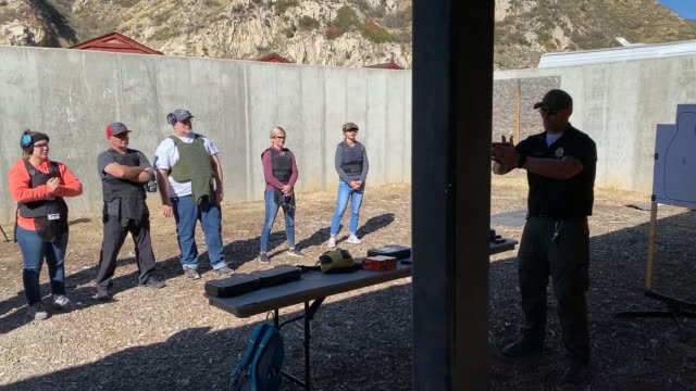 teachers from utah fire live ammunition with handguns at targets as part of their live fire training in thistle, utah, u.s. on saturday, october 5,... - thistle stock videos & royalty-free footage