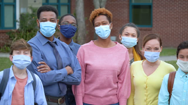 teachers, middle school students stand together, in masks - 55 59 years stock videos & royalty-free footage
